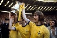 "The Arsenal first wore a golden Yellow shirt in the FA CUP final in 1950 and again in the 1971 final. From elder fan's I have spoke to the ""she wore a yellow ribbon"" song was sung in the late 50's but took until the 70's to really become popular."